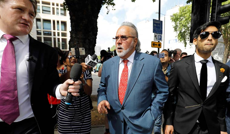 Vijay Mallya (C) leaves after appearing at Westminster Magistrates Court in central London | AFP