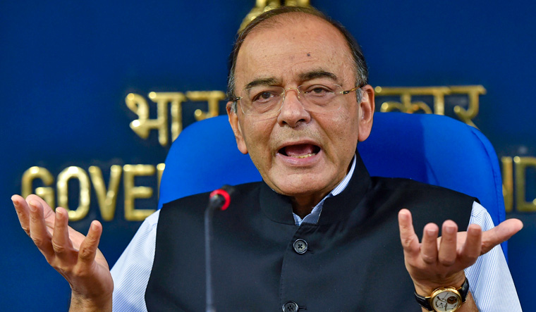 Finance Minister Arun Jaitley speaks during a press conference, in New Delhi on Wednesday