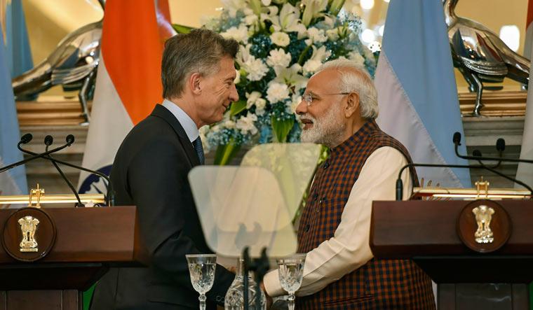 Prime Minister Narendra Modi exchanges greetings with Argentina's President Mauricio Macri | PTI