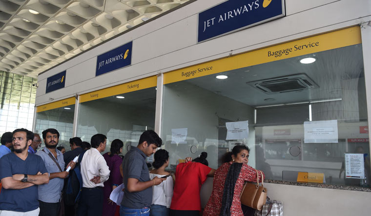 Passengers stand at the Jet Airways ticketing counter for cancelling their tickets at Chattrapati Shivaji International Airport in Mumbai | AFP
