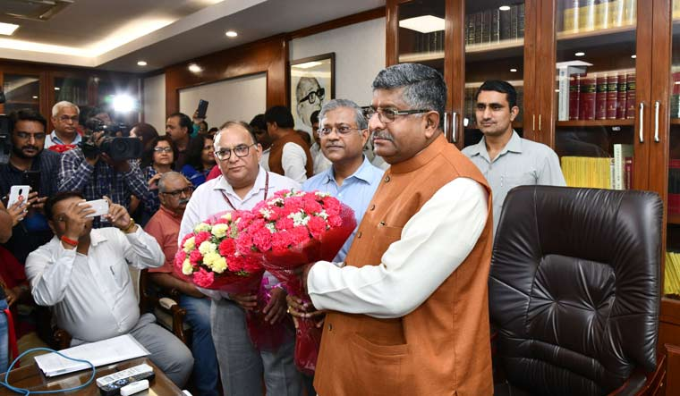 Ravi Shankar Prasad takes charge as the telecom minister at his office, in New Delhi | Sanjay Ahlawat