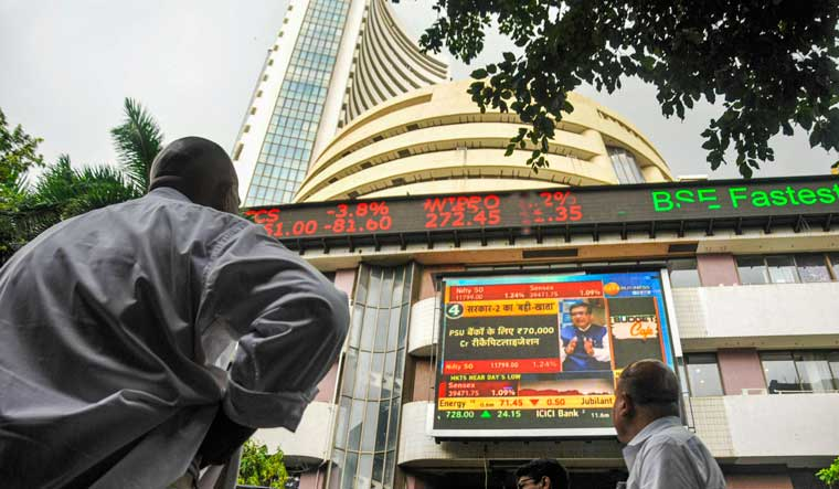 The stock market index on a display screen at the Bombay Stock Exchange (BSE) building in Mumbai | PTI