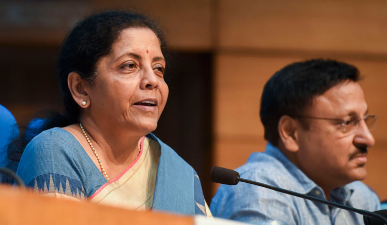Finance Minister Nirmala Sitharaman with finance secretary Rajiv Kumar during a press conference in New Delhi | PTI