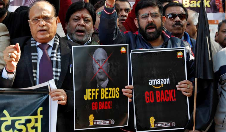 Jeff-bezos-traders-protest-india-Reuters