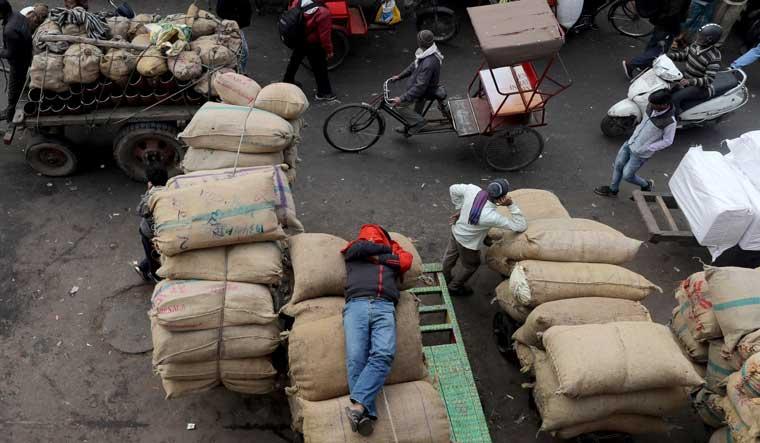 labourer-sleeps-wholesale-market-delhi-Reuters
