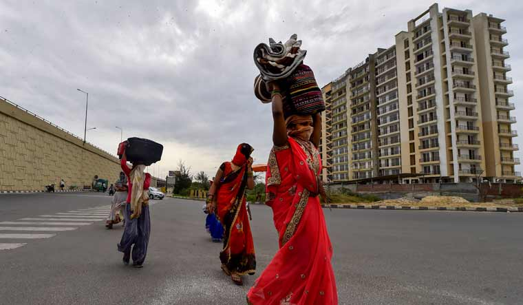 A group of migrant workers walk to their villages amid the nationwide complete lockdown, on the NH24 near Delhi-UP Border in New Delhi | PTI