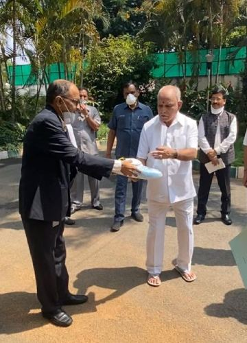 SST handed over 3,000 PPE kits and 10,000 N95 masks to Karnataka Chief Minister B.S. Yediyurappa