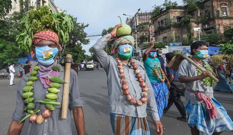 Farmers take part in a protest rally by All India Trinamool Congress party against the farm bills passed in Parliament, in Kolkata | PTI