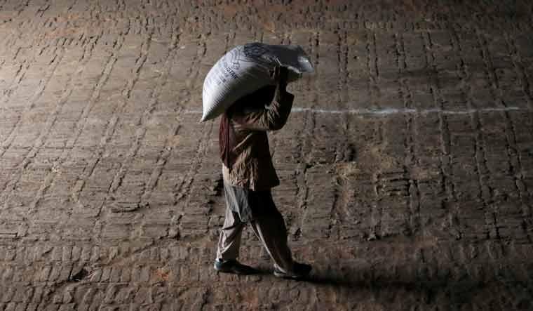man-carrying-sack-sugar-reuters