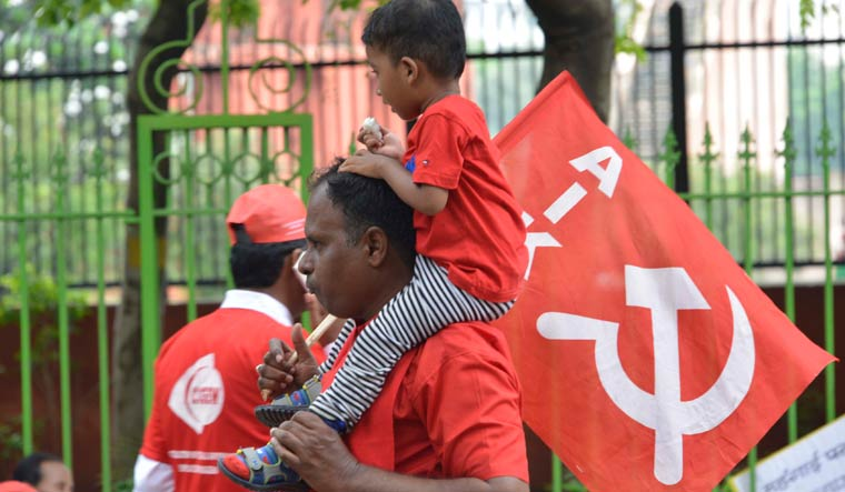 A protester holds a boy on his shoulder during a rally in Delhi | Arvind Jain