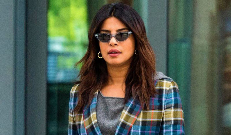 Priyanka Chopra Takes the Clear Shoe Trend to the Royal Wedding