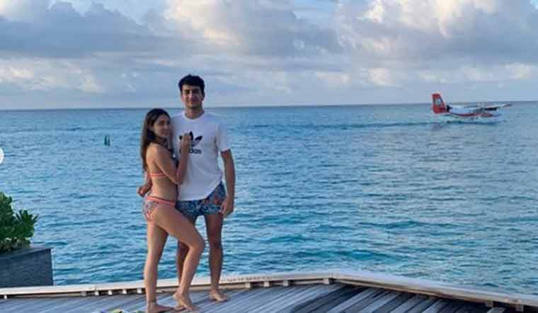 Image result for sara ali khan beach pics with brother