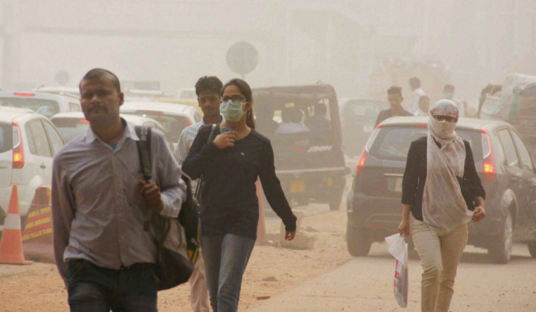 [File] People wearing mask to cope with severe air pollution in New Delhi | PTI
