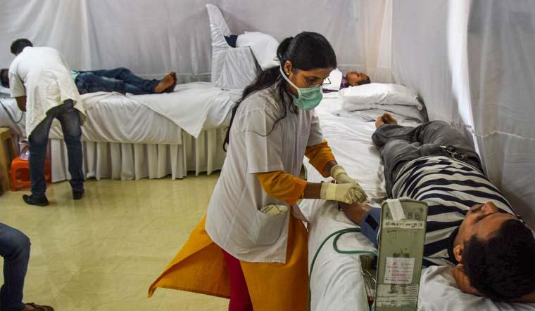 Volunteers donate blood at at a camp organised at Lalbagcha Raja Society premises to support coronavirus patients, in Mumbai | PTI