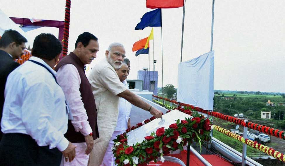 Prime Minister Narendra Modi releases water from the gates