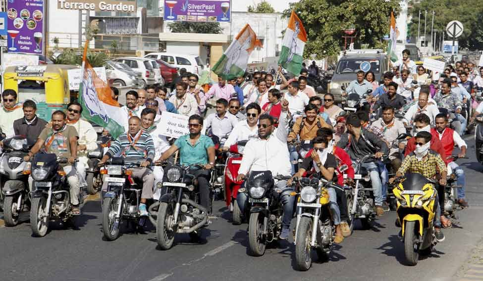 Congress workers take out a bike rally to protest against BJP president Amit Shah and Prime Minister Narendra Modi in Ahmedabad