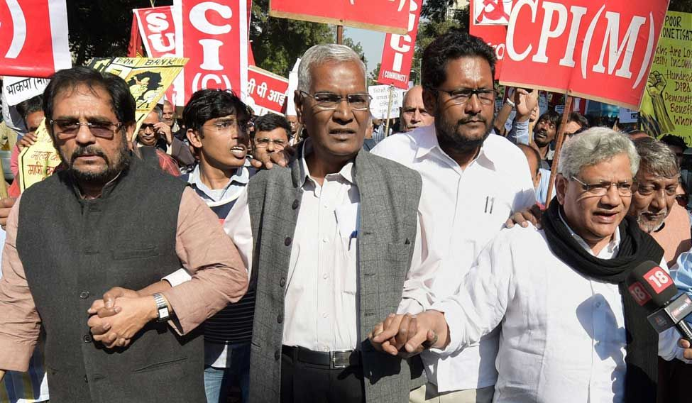 CPI(M) General Secretary Sitaram Yechury with CPI's Atul Kumar Anjan and D. Raja during a protest march from Mandi House to Jantar Mantar