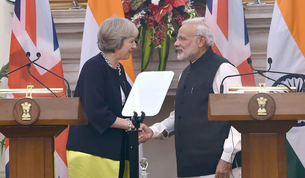 Prime Minister Narendra Modi and UK Prime Minister Theresa May shake hands in New Delhi