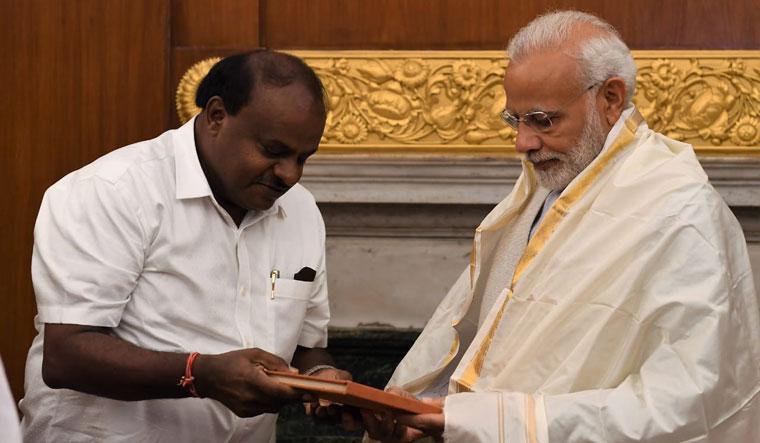 Chief Minister H.D. Kumaraswamy presenting a book