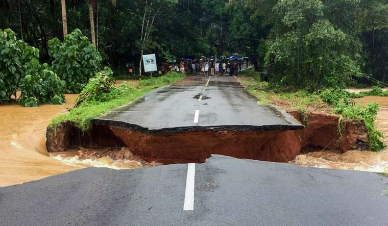 A section of road is seen washed away following a flash flood at Wandoor in Malappuram district | PTI