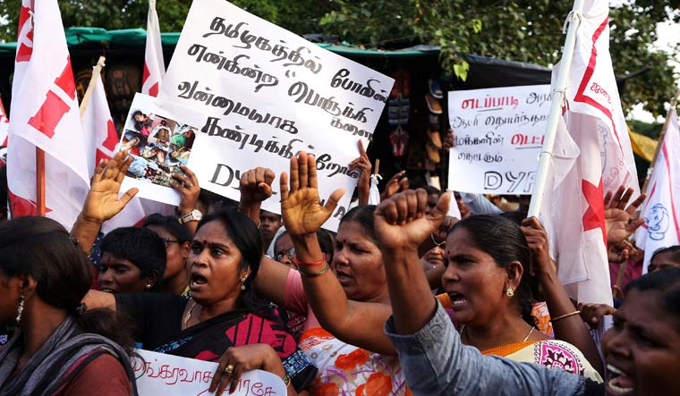 Women shout slogans during a protest after 11 people were killed in police firing in Thootukudi | Reuters