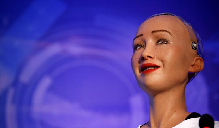 Sophia, a robot with Saudi Arabian citizenship, interacts during the innovation fair in Kathmandu | Reuters