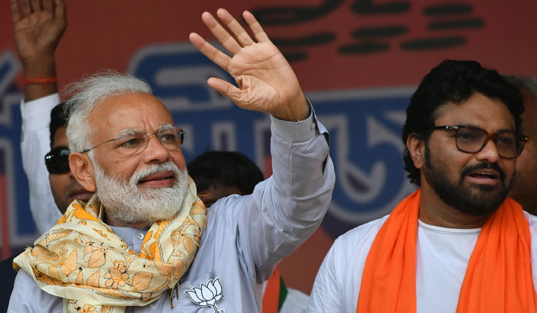 Prime Minister Narendra Modi waves at his supporters during an election rally at Asansol in West Bengal on Tuesday | Salil Bera