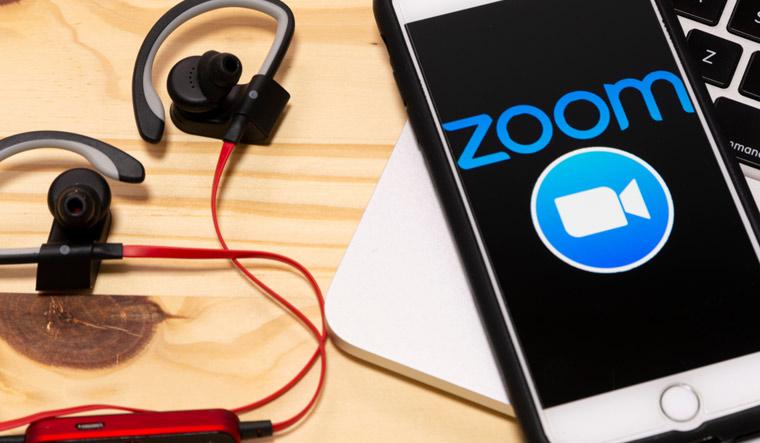 Smartphone-showing-Zoom-Cloud-meetings-application-logo-on-an-a-screen-shut
