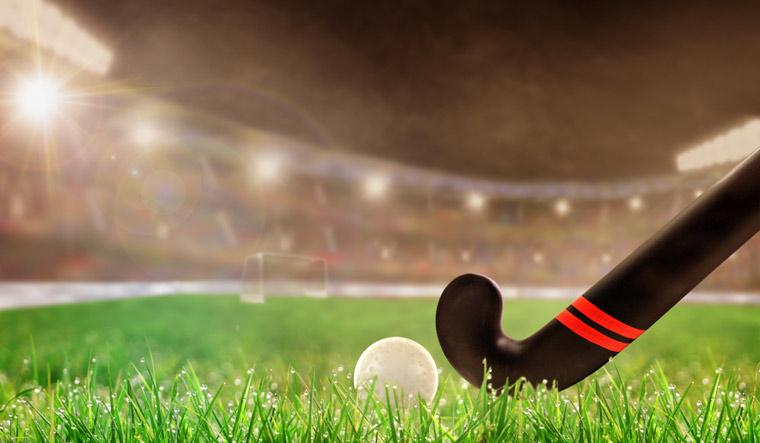 hockey-Field-hockey-stick-ball-on-grass-shut