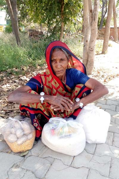 One of the villagers in Mirzapur with dry ration provided by the team at Kachhwa Christian hospital
