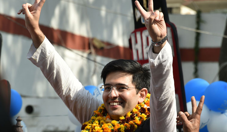 Aam Aadmi Party (AAP) leader Raghav Chadha displays the victory sign after his victory in the Delhi Assembly polls, at AAP office in New Delhi   Aayush Goel