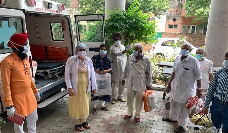 COVID-19 patients being discharged from a hospital in Jalandhar | Aayush Goel