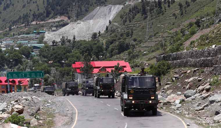 [File] Indian Army trucks move along a highway leading to Ladakh, at Gagangeer in Kashmir's Ganderbal district   Reuters