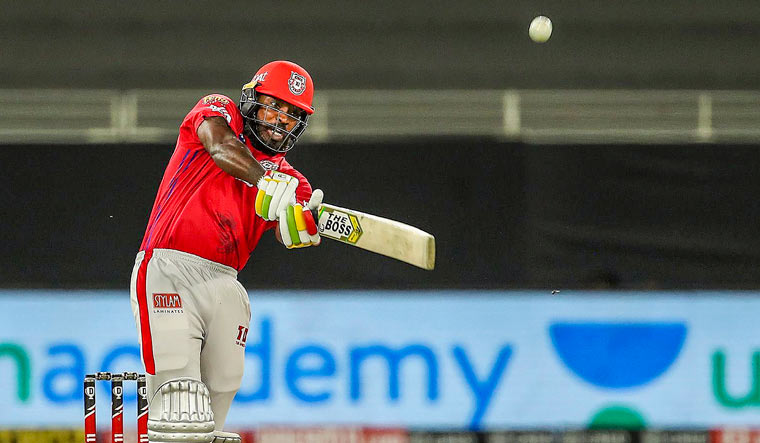 Kings XI Punjab player Chris Gayle plays a shot during their Indian Premier League cricket match against Mumbai Indians | PTI