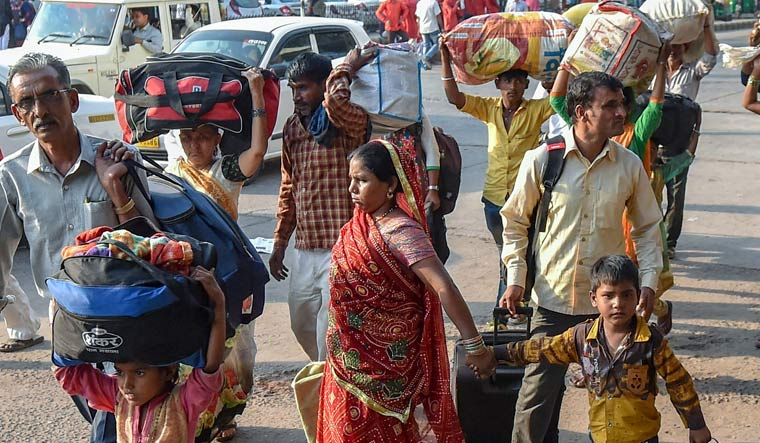 Migrant workers from Uttar Pradesh and Bihar leave for their homes in the view of protests and violence which broke out over the alleged rape of a 14-month-old girl in Ahmedabad | PTI