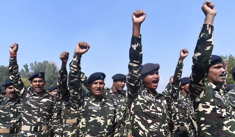 Indian troopers shout slogans after paying homage to a fallen colleague during a wreath laying ceremony in Srinagar on Monday | AFP