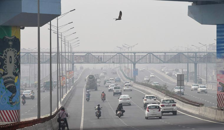 Motorists drive as smog covers the skyline in New Delhi | AFP