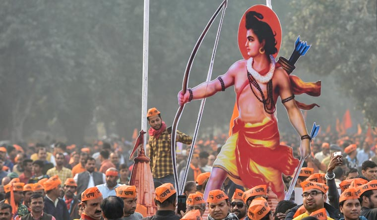 VHP supporters carry a cutout of Lord Ram during 'Dharma Sabha' at Ramlila Maidan in Delhi | PTI