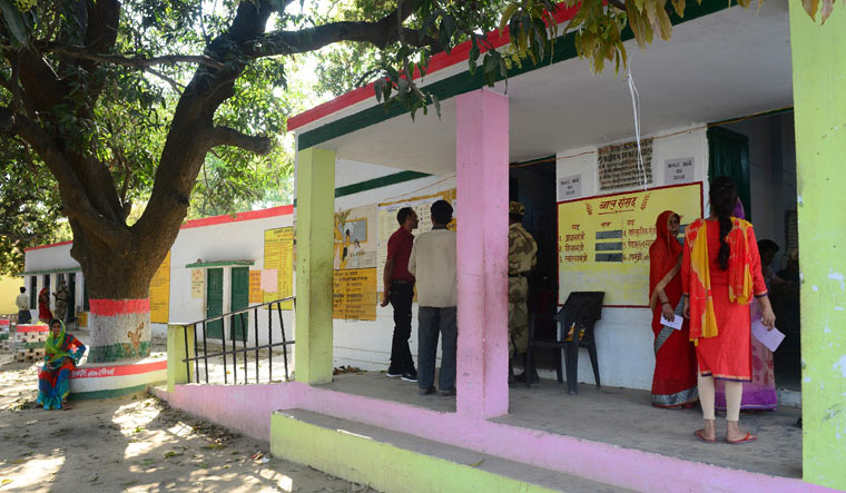 Voters wait to cast their ballots during the by-election for the Phulpur Lok Sabha seat on March 11   AFP