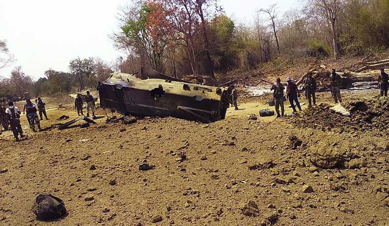 Security personnel inspect the site of an IED blast where nine CRPF personnel were killed by Maoists | PTI