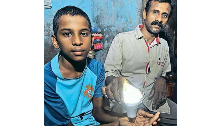 This boy can light up a bulb by merely holding it
