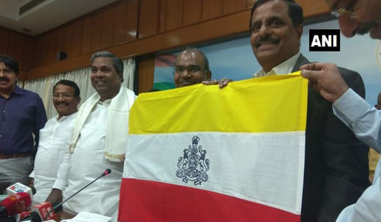 Ahead of polls Sidda unveils proposed Karnataka flag