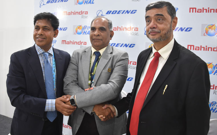 [L-R] Pratyush Kumar, Boeing India president, T. Suvarna Raju, chairman and MD of HAL and S.P. Shukla, president, Aerospace and Defence, mahindra | Arvind Jain
