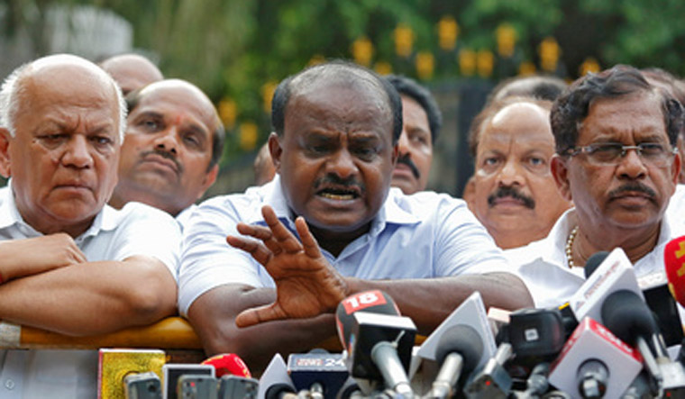 H. D. Kumaraswamy speaks to the media after handing over a letter of support from elected legislators to the governor | Reuters