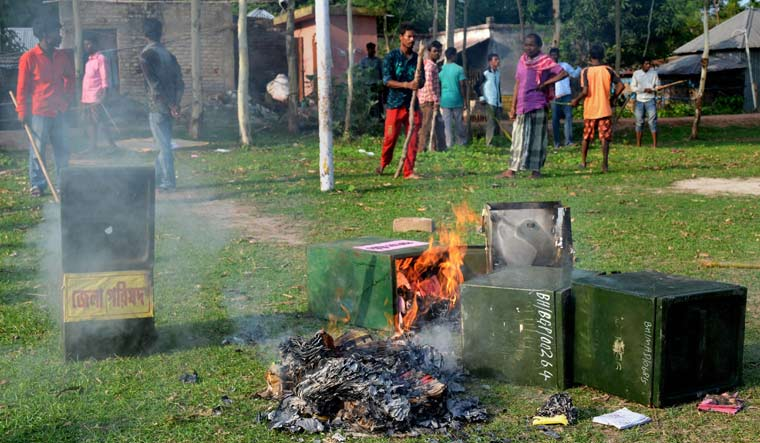 Unknown people burn ballot boxes after snatching them from a polling booth during panchayat polls at Deotala in Malda district of West Bengal | PTI