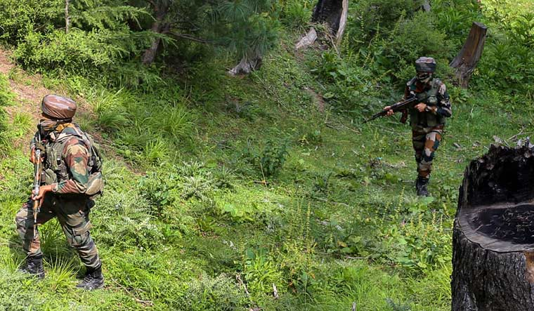 [FILE] Army personnel take positions during an encounter with the militants in Keran Sector of Kupwara district of north Kashmir on Sunday | PTI