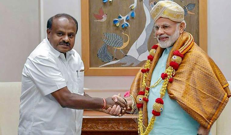 [FILE] Karnataka Chief Minister H.D. Kumaraswamy meets Prime Minister Narendra Modi in New Delhi | PTI