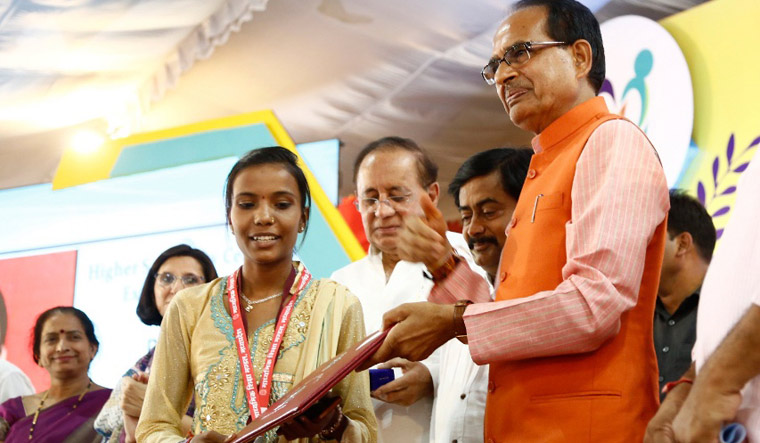 Madhya Pradesh Chief Minister Shivraj Singh Chouhan giving away prizes to students who topped in MP board exams