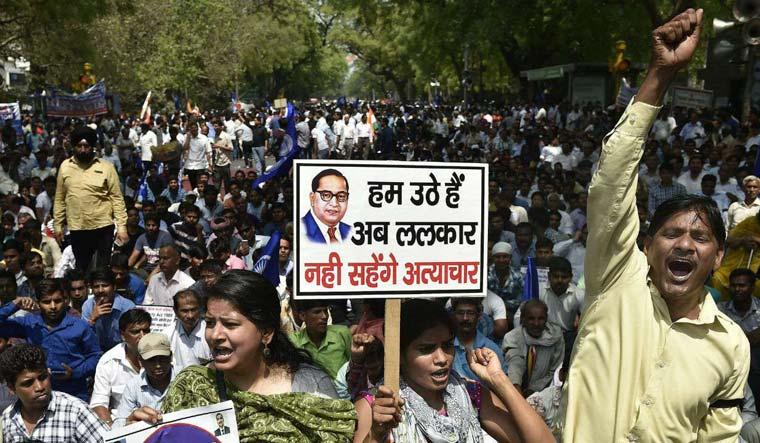 [FILE] Members of dalit community raise slogans during 'Bharat Bandh' on April 2   PTI