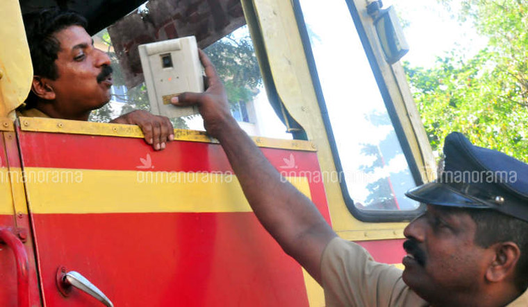 A police officer carrying out an alcometer test | Onmanorama